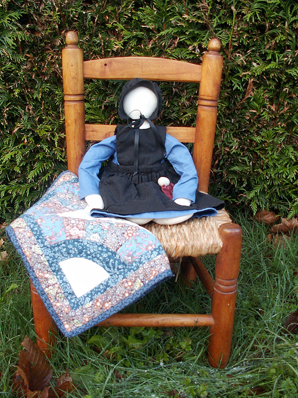 Amish doll with patchwork and baby doll
